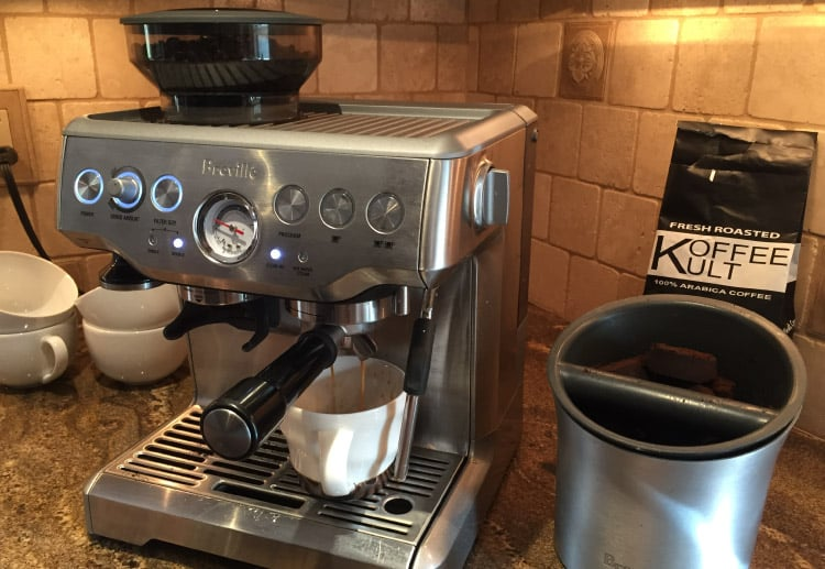 my breville barista express brewing up one of my favorite coffee beans koffee kult dark roast